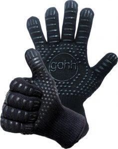 Twee zwarte handschoenen met vingers met glimmende nopjes